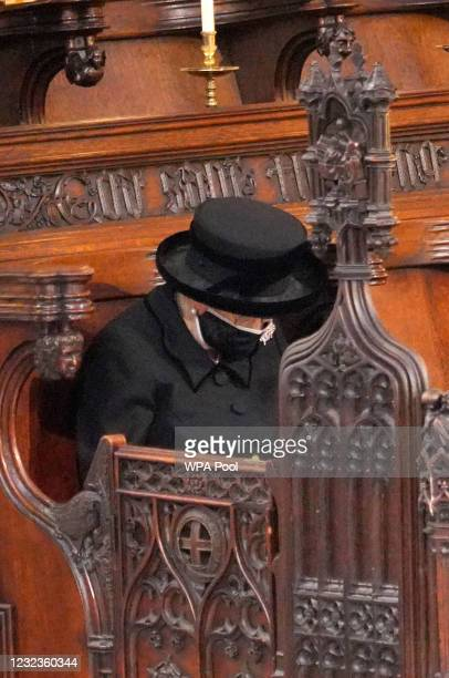 Queen Elizabeth II bows her head during the funeral of Prince Philip, Duke of Edinburgh, at St George's Chapel at Windsor Castle on April 17, 2021 in...