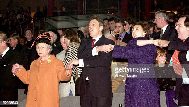 Queen Elizabeth II, British Prime Minister Tony Blair, and his wife Cherie Blair during the Millenium New Year celebrations on December 31, 1999 at...