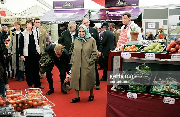 Queen Elizabeth II browses the show stalls and shops on the second day of Royal Windsor Horse Show on May 11, 2007 in Berkshire, England.