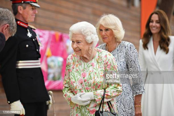 Queen Elizabeth II, Camilla, Duchess of Cornwall and Catherine, Duchess of Cambridge arrive to attend an event in celebration of The Big Lunch...