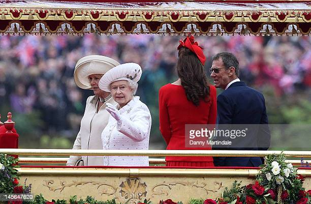 Queen Elizabeth II Camilla Duchess of Cornwall and Catherine Duchess of Cambridge take part in The Thames River Pageant as part of the Diamond...