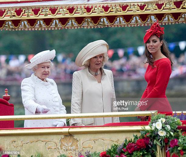Queen Elizabeth II Camilla Duchess of Cornwall and Catherine Duchess of Cambridge look out from the Spirit of Chartwell during the Diamond Jubilee...