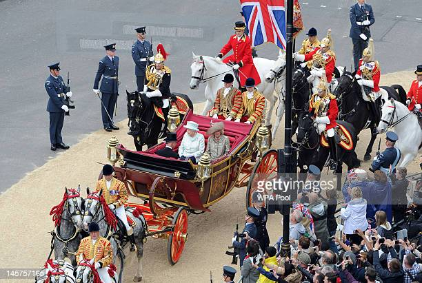 Queen Elizabeth II Camilla Duchess of Cornwall and Prince Charles Prince of Wales leave Westminster Hall after a Diamond Jubilee Luncheon given for...
