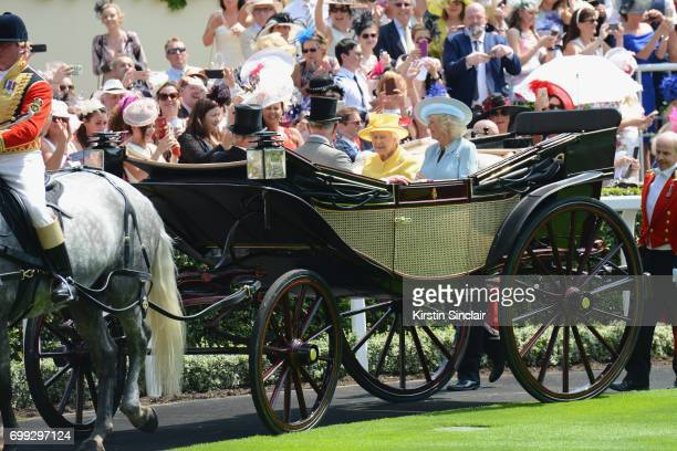 Queen Elizabeth II, Camilla, Duchess of Cornwall, Lord Fellowes and Prince Charles, Prince of Wales enter the parade ring during the Royal Procession...