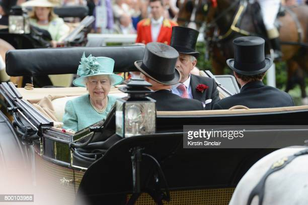 Queen Elizabeth II, Captain David Bowes-Lyon, Mr Erik Penser and Mr Thomas van Straubenzee arrive in the Royal Procession on day 4 of Royal Ascot...