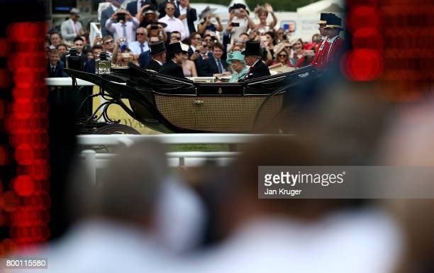 Queen Elizabeth II, Captain David Bowes-Lyon, Mr Erik Penser and Mr Thomas van Straubenzee arrive on day 4 of Royal Ascot at Ascot Racecourse on June...