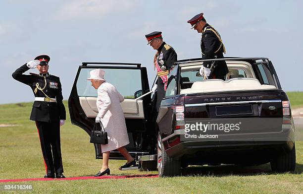 Queen Elizabeth II CaptainGeneral of the Royal Regiment of Artillery oversees a Royal Review from an opentop Range Rover on the occasion of their...