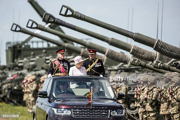 Queen Elizabeth II CaptainGeneral of the Royal Regiment of Artillery oversees a Royal Review on the occasion of their Tercentenary at Knighton Down...