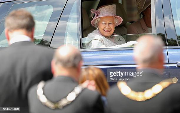 Queen Elizabeth II CaptainGeneral of the Royal Regiment of Artillery waves as she leaves the Royal Garrison Church after unveiling a foundation stone...