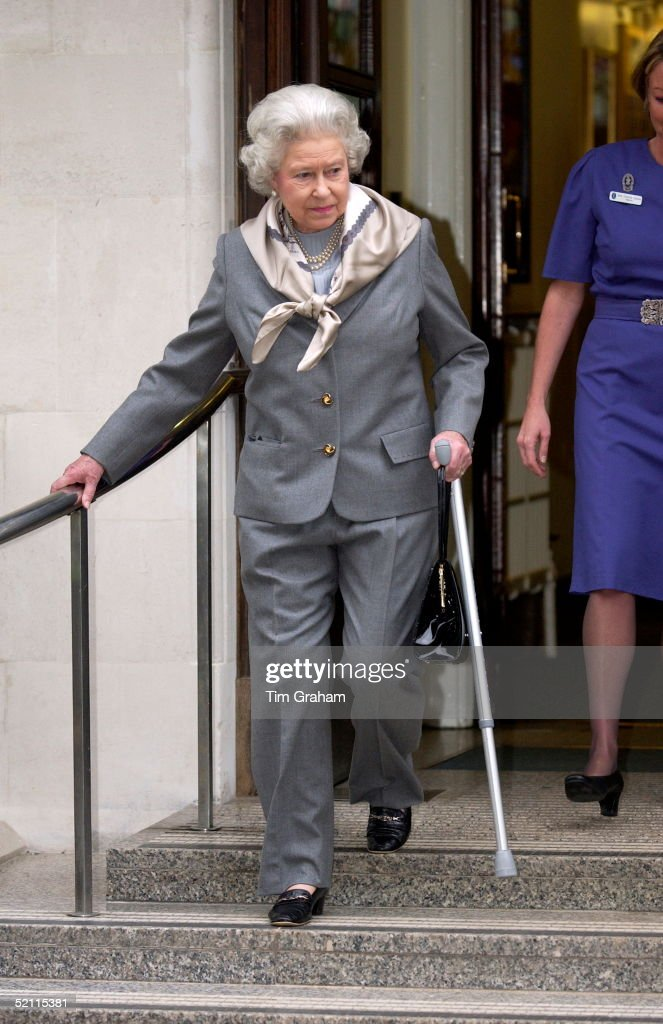Queen Walking Stick And Trousers : News Photo