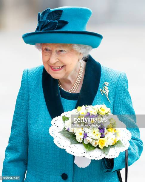 Queen Elizabeth II carries a nosegay as she attends the traditional Royal Maundy service at Leicester Cathedral on April 13 2017 in Leicester England...