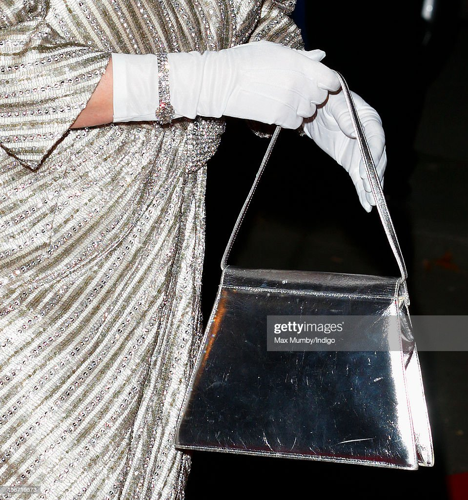 Queen Elizabeth II carries a silver coloured handbag as she attends the Royal Variety Performance, in the 100th anniversary year, at the Royal Albert Hall on November 19, 2012 in London, England.