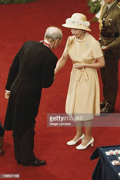 Queen Elizabeth II carries out an investiture ceremony in Wellington during her tour of New Zealand, 1977.