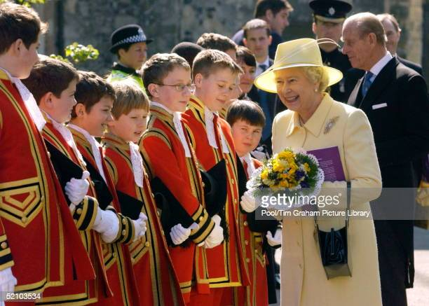 Queen Elizabeth II Carrying A Nosegay Historically Intended To Ward Off Disease And Evil Spirits Meets The Choral Choir At Canterbury Cathedral After...