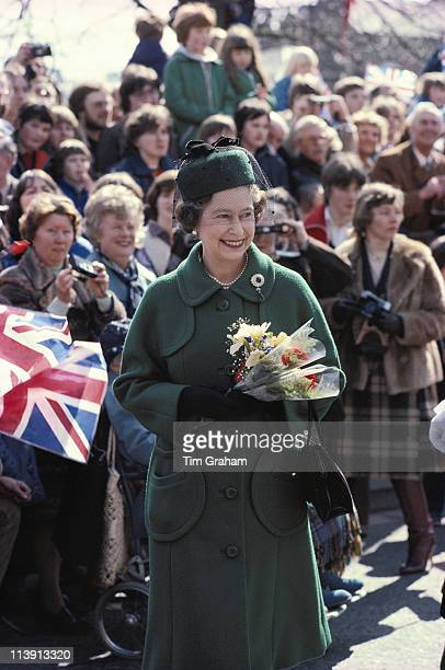 Queen Elizabeth II carrying a small posy of flowers on a walkabout in Worcester Worcestershire England Great Britain 3 April 1980 The Queen was in...