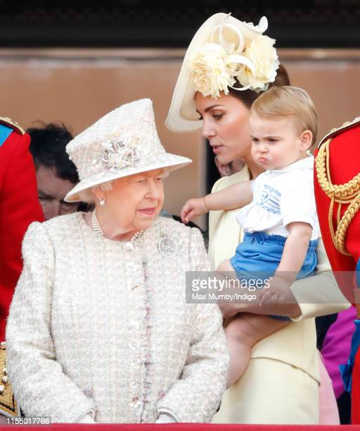 Queen Elizabeth II, Catherine, Duchess of Cambridge and Prince Louis of Cambridge watch a flypast from the balcony of Buckingham Palace during...