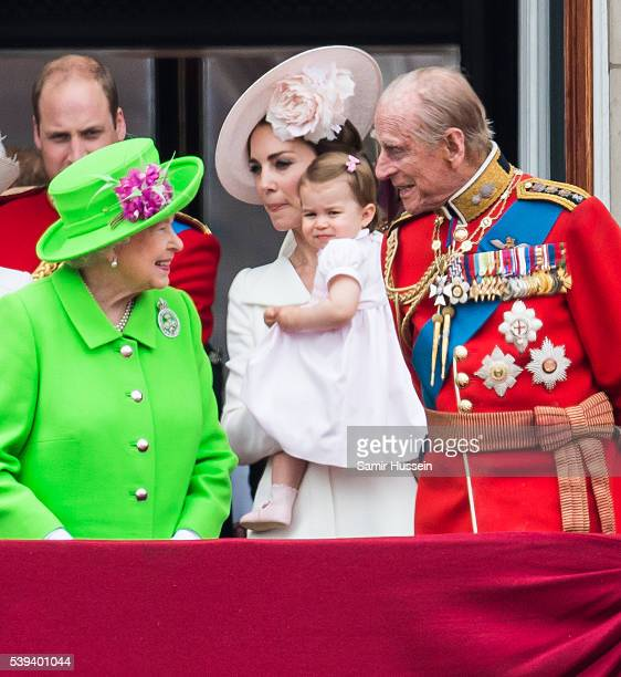 Queen Elizabeth II Catherine Duchess of Cambridge Princess Charlotte and Prince Philip Duke of Edinburgh stand on the balcony during the Trooping the...