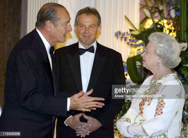 Queen Elizabeth II chats to French President Jacques Chirac and Britain's Prime Minister Tony Blair at Gleneagles, Scotland, Wednesday 6 July 2005....