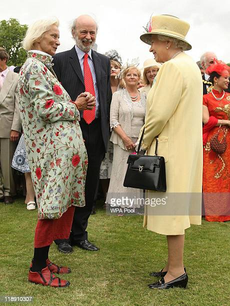 Queen Elizabeth II chats to guests Susan Ward and Professor Charles Ward from Budleigh Salterton Devon during a garden party at Buckingham Palace on...