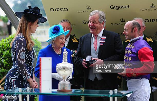 Queen Elizabeth II chats to Jockey Olivier Peslier after he guided Dartmouth to victory in the Hardwicke Stakes during Day Five of Royal Ascot 2016...