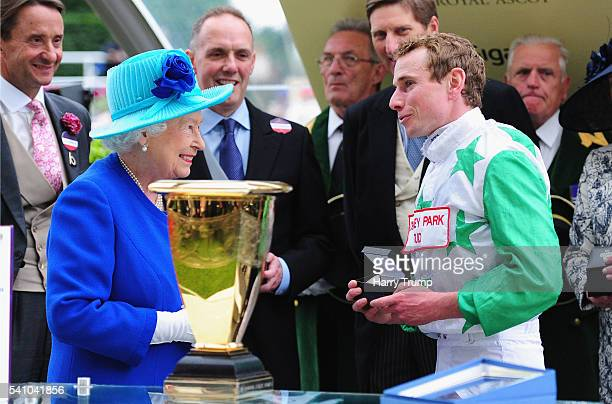 Queen Elizabeth II chats to Jockey Ryan Moore after his victory on board Twilight Son in the Diamond Jubilee Stakes during Day Five of Royal Ascot...