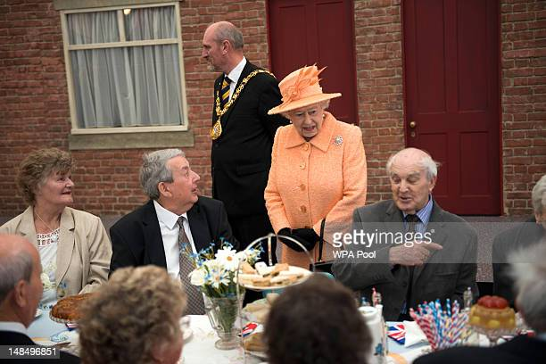 Queen Elizabeth II chats to people attending a street party during her visit on July 18 2012 in Sunderland England During a twoday visit to the North...