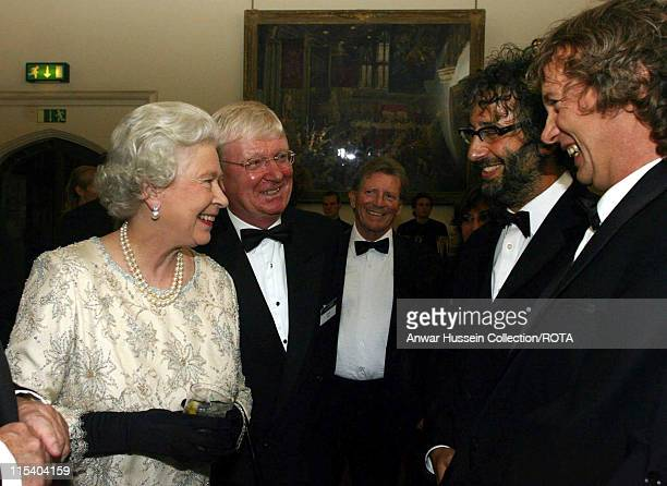 Queen Elizabeth II chats with comedians Frank Skinner and David Baddiel at the ITV 50th Anniversary celebration while Coronation Street actor Johnny...