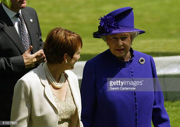 Queen Elizabeth II chats with Culture Secretary Tessa Jowell as they attend the opening of the Diana Memorial Fountain in memory of the late Princess...
