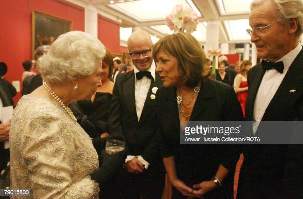 Queen Elizabeth II chats with guests at the ITV 50th Anniversary celebration including Nicholas Parsons Lynda Bellingham and Harry Hill on Thursday...