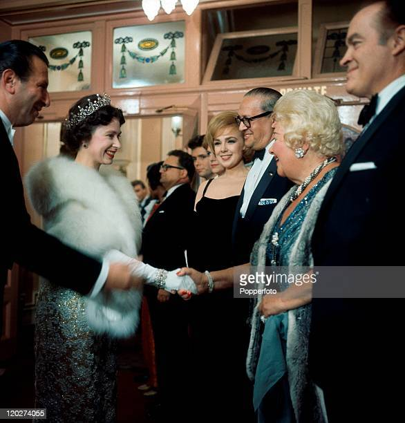 Queen Elizabeth II chatting to Bob Hope Sophie Tucker and other personalities following the Royal Variety performance in London circa 1962