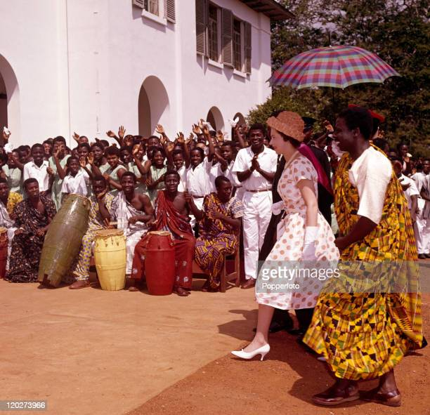 Queen Elizabeth II cheered by schoolboys and others during the Royal Tour of West Africa in Accra Ghana circa December 1961