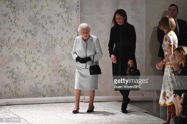 Queen Elizabeth II Chief Executive of the British Fashion Council Caroline Rush and Anna Wintour attend the Richard Quinn show during London Fashion...