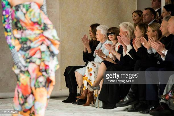 Queen Elizabeth II Chief Executive of the British Fashion Council Caroline Rush and Anna Wintour watch model Adwoa Aboah walking the runway at the...