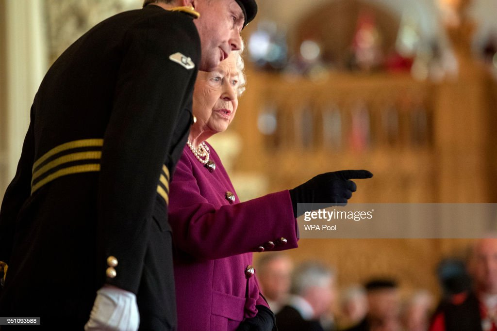Queen Elizabeth II, Colonel-in-Chief of the Royal Tank Regiment, is seen as she presents the regiment with their new standard in St George's Hall at Windsor Castle on April 25, 2018 in Windosr, England.