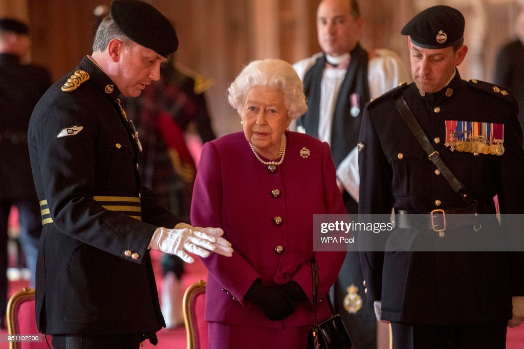 Queen Elizabeth II, Colonel-in-Chief of the Royal Tank Regiment, is seen before posing for a photograph after presenting the regiment with their new standard in St George's Hall at Windsor Castle on April 25, 2018 in Windosr, England.