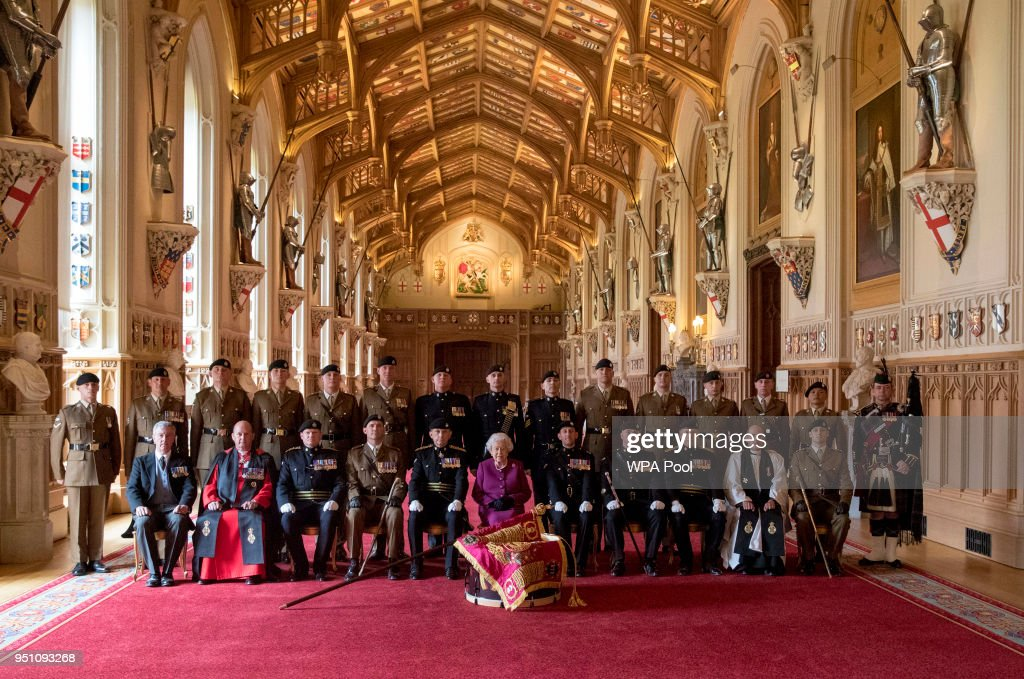 Queen Elizabeth II, Colonel-in-Chief of the Royal Tank Regiment, poses for a photograph after presenting the regiment with their new standard in St George's Hall at Windsor Castle on April 25, 2018 in Windosr, England.