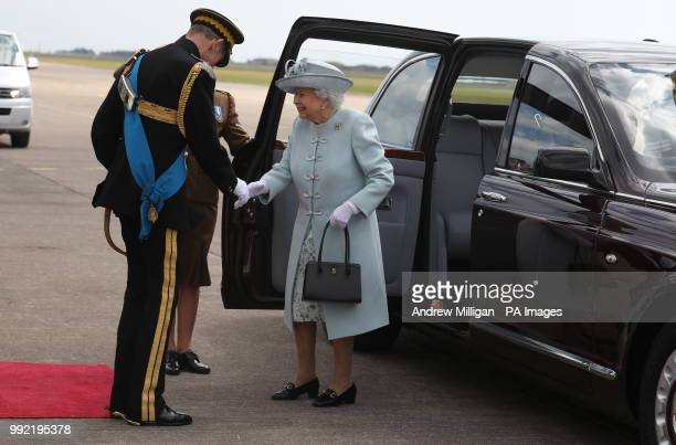 Queen Elizabeth II ColonelinChief Royal Scots Dragoon Guards is met by the Duke of Kent Deputy ColonelinChief as she arrives to present a new...