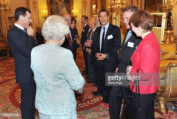 Queen Elizabeth II comments on Bear Grylls' Union Flag shoes as Michael Palin and Dr Helen Sharman as the Queen and Duke of Edinburgh host a...