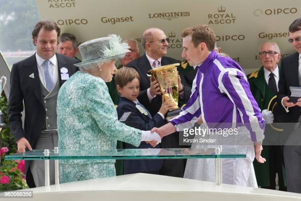 Queen Elizabeth II congratulates Ryan Moore who rode Merchant Navy to win The Diamond Jubilee Stakes on day 5 of Royal Ascot at Ascot Racecourse on...