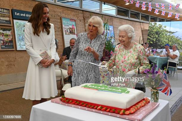 Queen Elizabeth II considers cutting a cake with a sword, lent to her by The Lord-Lieutenant of Cornwall, Edward Bolitho, to celebrate of The Big...