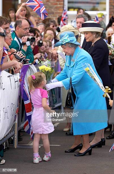 Queen Elizabeth II Continuing Her Jubilee Tour Receiving A Bunch Of Flowers From A Girl In The Crowd Standing Behind The Queen Is Her Lady In Waiting...