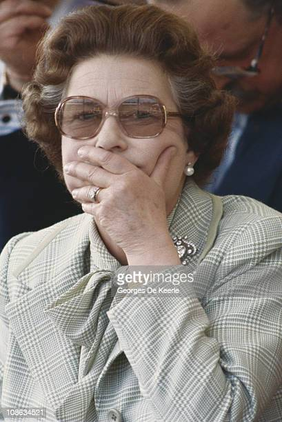 Queen Elizabeth II covering her mouth with her hand circa 1980