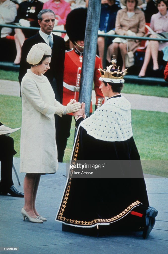 Queen Elizabeth II crowns her son Charles, Prince of Wales, during his investiture ceremony at Caernarvon Castle, 1st July 1969.