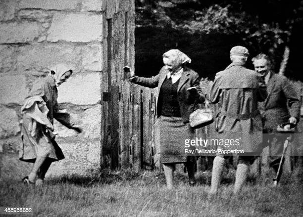 Queen Elizabeth II dancing the 'twist' during a picnic in the grounds of Balmoral Castle in Aberdeenshire on 27th August 1962 This image is one of a...