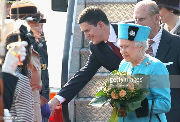 Queen Elizabeth II David Miliband and Prince Philip Duke of Edinburgh arrive at Joze Pucnik airport on the first day of a two day tour of Slovenia on...
