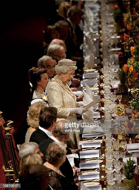 Queen Elizabeth II delivers a speech before a banquet held during the state visit of Qatar's Emir Sheikh Hamad bin Khalifa alThani and his wife...