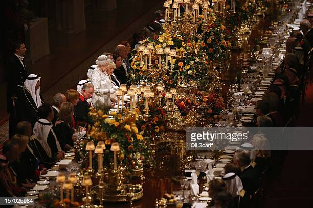 Queen Elizabeth II delivers a speech during a State Banquet for His Highness the Amir Sheikh Sabah Al-Ahmad Al-Jaber Al-Sabah of Kuwait in Windsor...