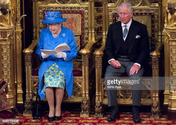 Queen Elizabeth II delivers the Queen's Speech whilst sat next to Prince Charles Prince of Wales during the State Opening of Parliament in the House...