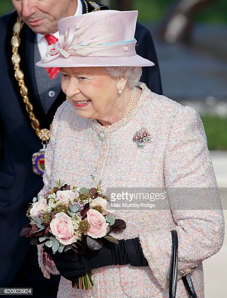 Queen Elizabeth II departs after unveiling a statue depicting herself alongside a mare and it's foal in 1977 on November 3 2016 in Newmarket England