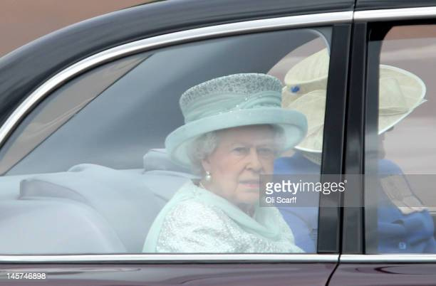 Queen Elizabeth II departs Buckingham Palace during the Diamond Jubilee carriage procession prior to the service of thanksgiving at StPaul's...